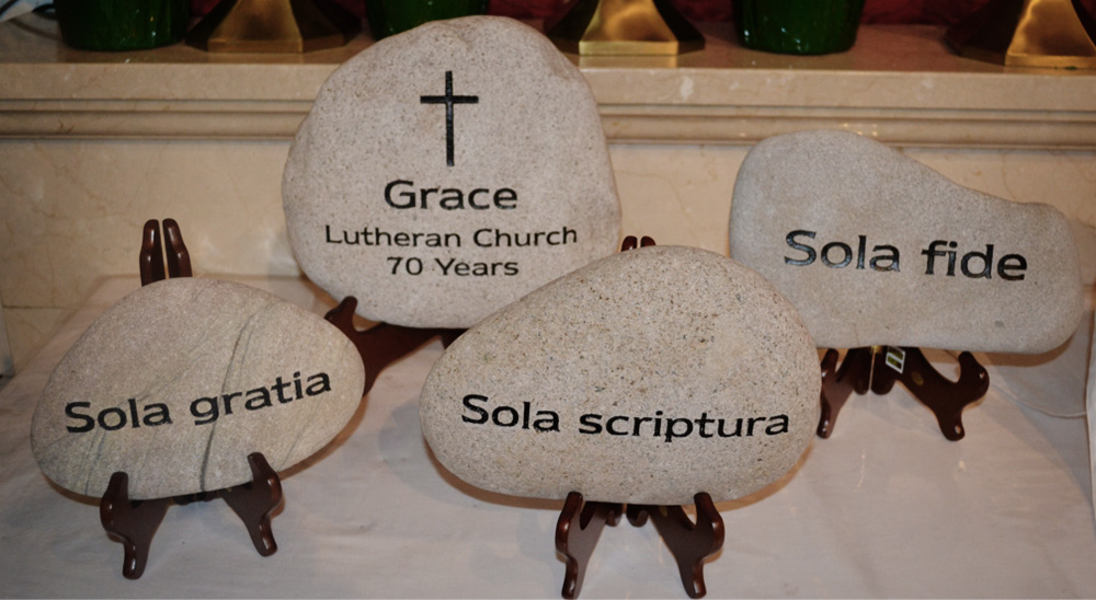 In honor of Grace Lutheran's 70th Anniversary in 2012, the church dedicated four rocks. The largest centerpiece acknowledges the 70 years of Grace Lutheran. Three additional rocks are inscribed with the Latin phrases: Sola fide (Faith alone), Sola gratia (Grace alone), and Sola scriptura (Scripture alone).